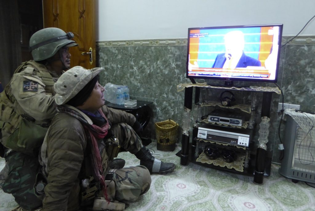 Eliya (right) and Zau Seng watching Trump Inauguration in a newly liberated neighborhood of NE Mosul