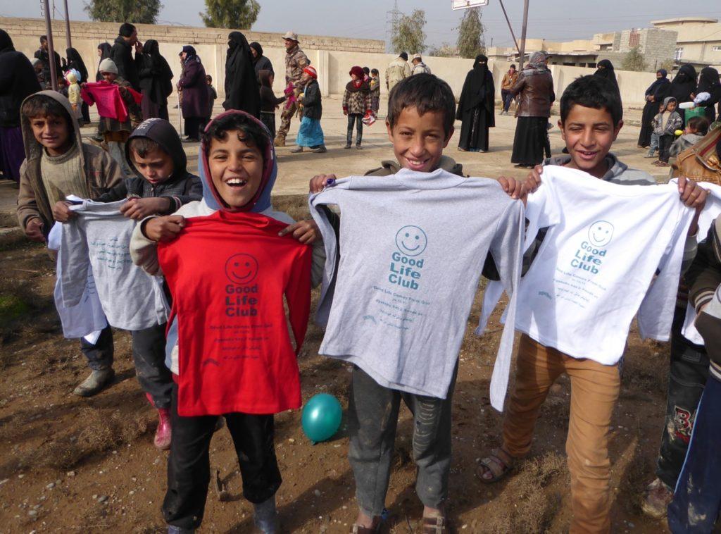 Mosul children get Good Life Club shirts after a kids program