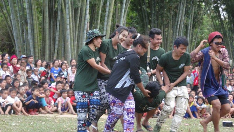 Rangers perform a drama about health to villagers