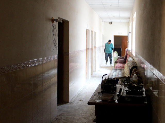 An Iraqi Federal Police E.R.D. Medic walks down the hall of the school-turned-emergency care center.