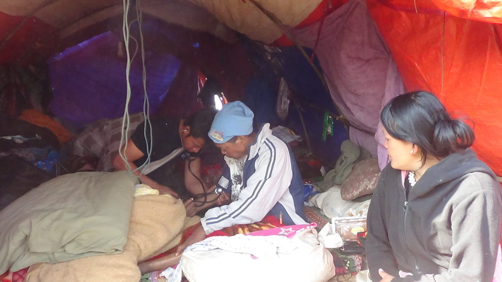 Karen medic treats IDP in her home