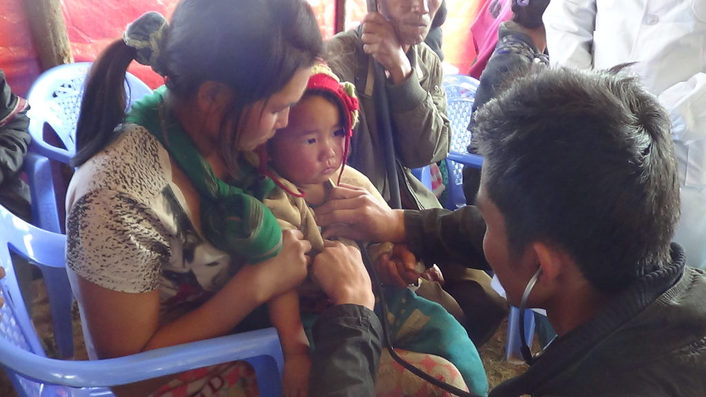 Karen medics treat Kachin patients
