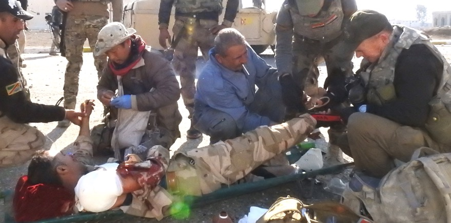 Eliya (Karen medic), Dave and Iraqi soldiers treat wounded in Mosul, Iraq
