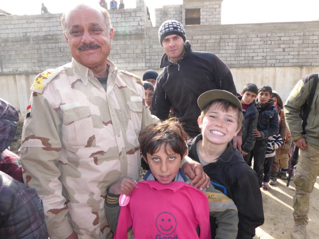 General Mustafa, commander of the 36th Iraqi Armored Brigade, after the battle of Salam hospital with Iraqi child and our son Peter at childrens program in Mosul