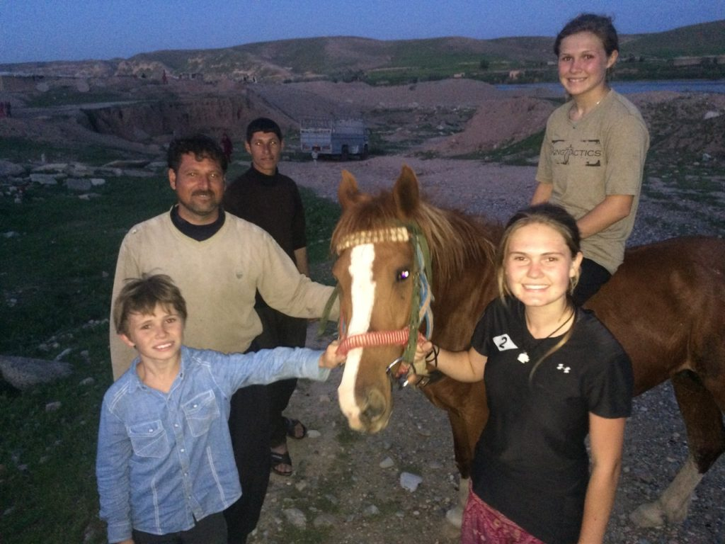 The horse back with his owner and the end of a good day, Easter in Iraq