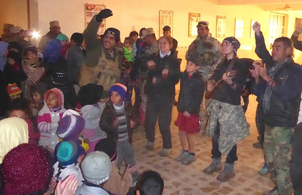 Iraqi soldier helps lead children's program in east Mosul