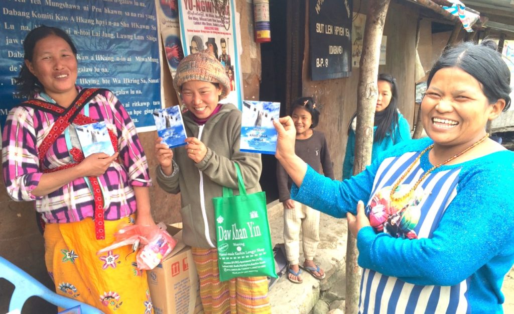 Kachin Christian IDPs with gospel tracts we gave them in a camp where they fled from the attacking Burma Army