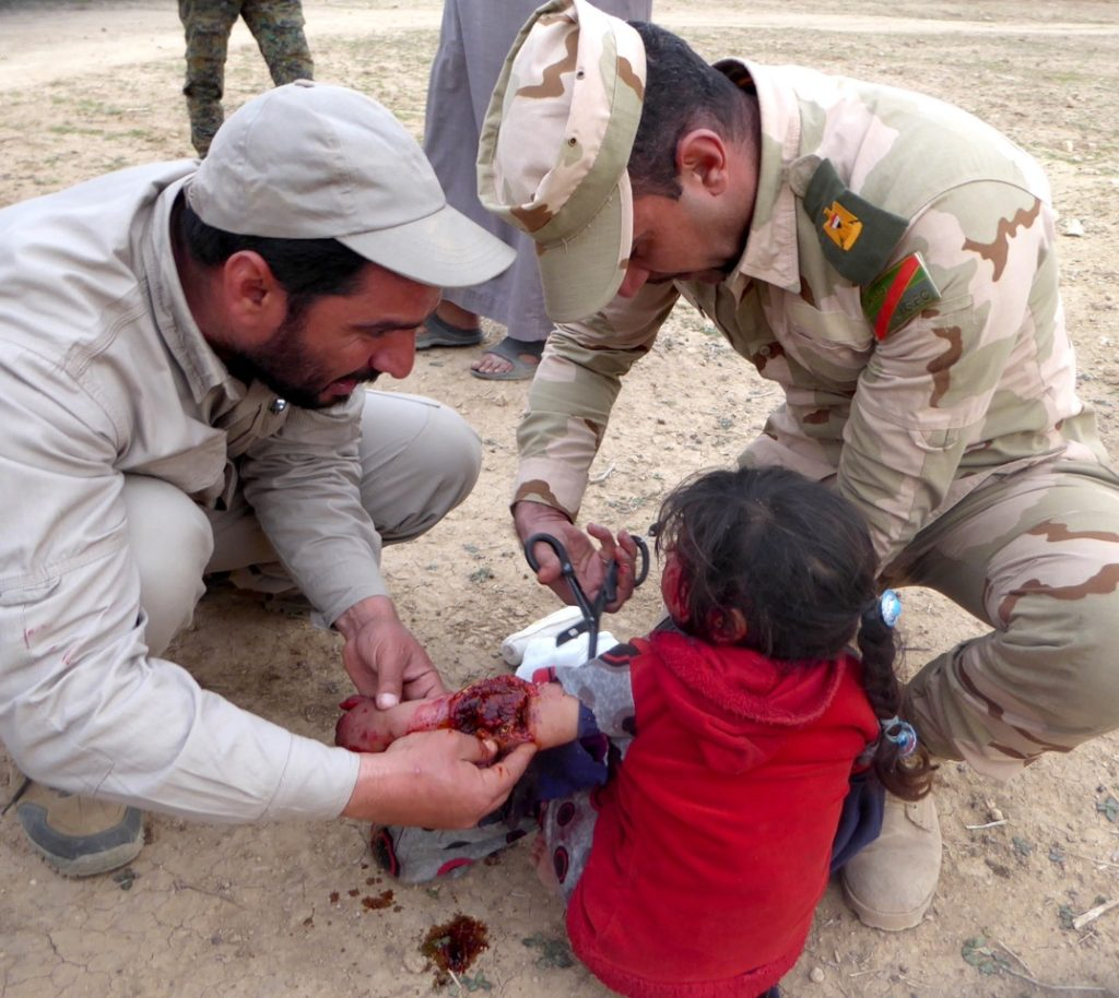 Major Naseem and Iraq Militia (PMU) treat child wounded by ISIS landmine in west Mosul