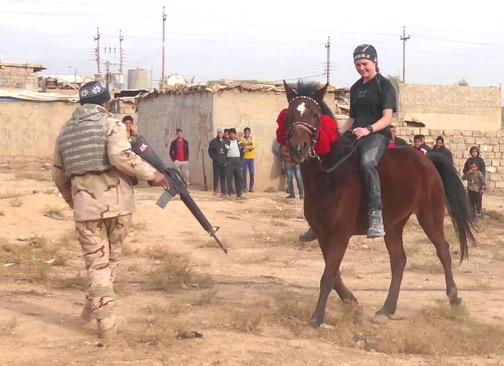 Sahale on a horse that survived ISIS in Mosul. Iraqi soldier gets out of the way!