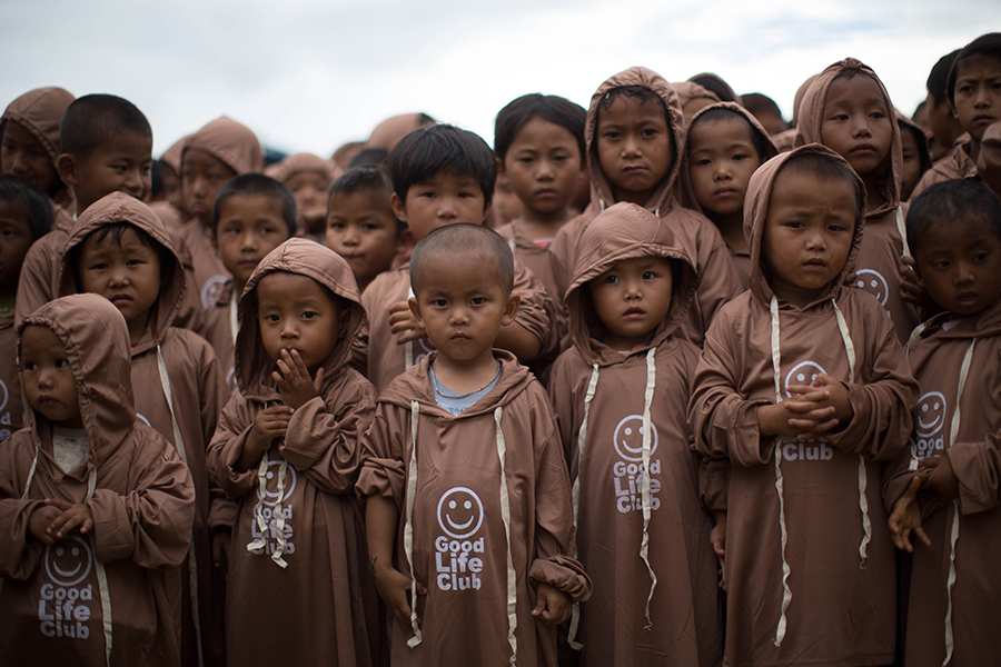 Children with their new Good Life Club (GLC) shirts at a GLC program in Kachin State, Burma. (2013)