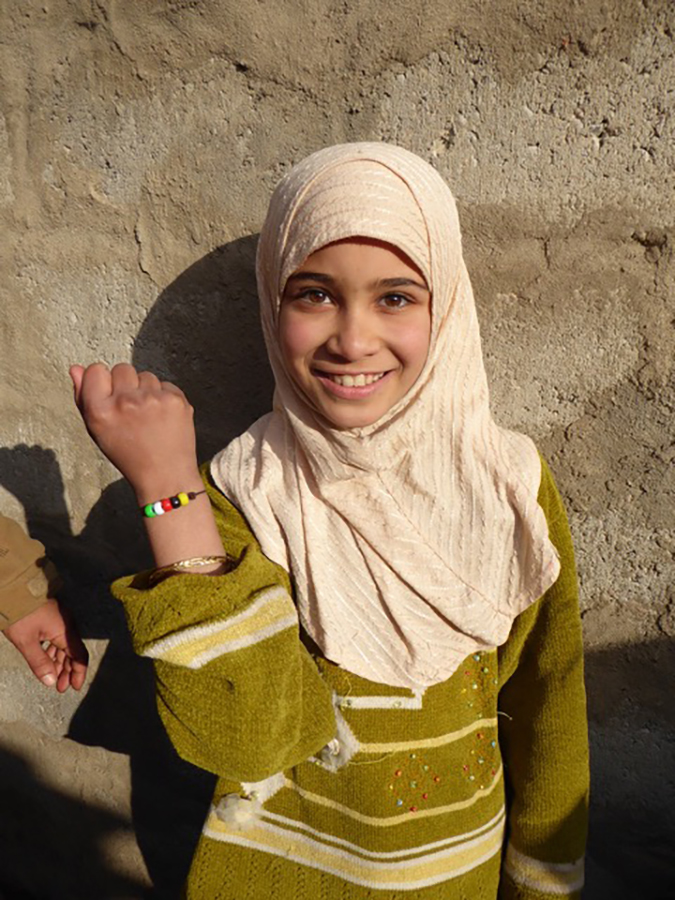 An Iraqi girl shows off her new GLC bracelet about Jesus' love in newly liberated eastern Mosul.