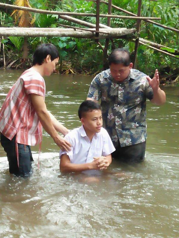 Ko Rin is baptized.