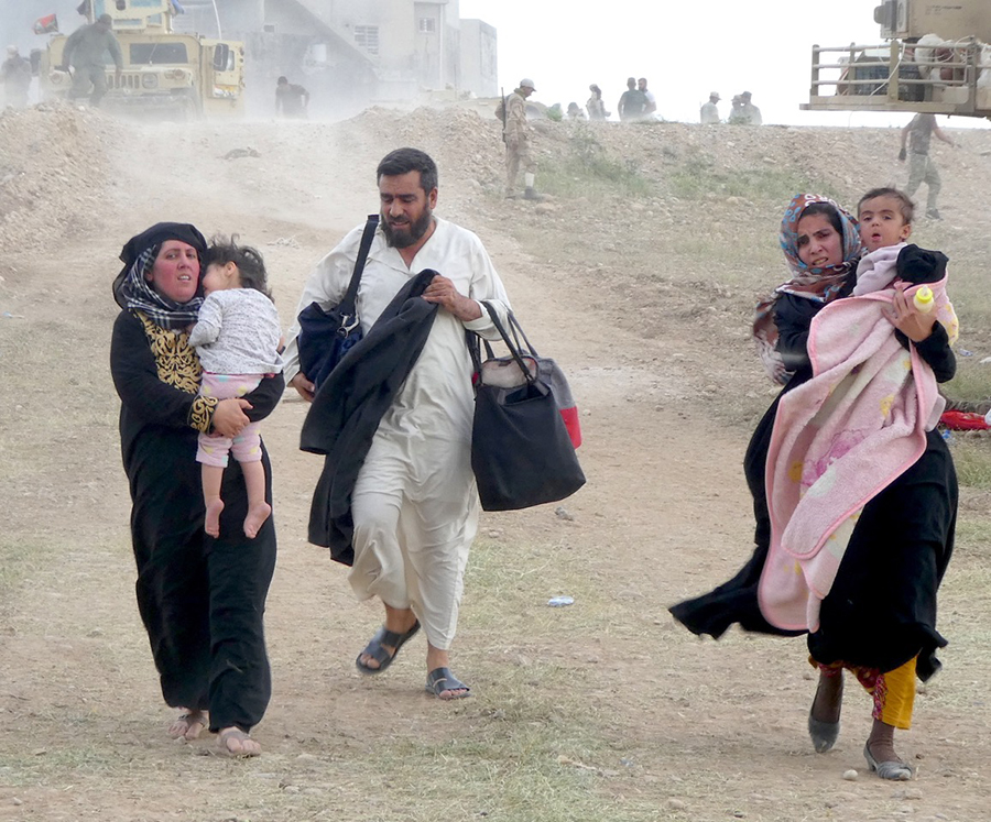 Families under ISIS fire flee Mosul.