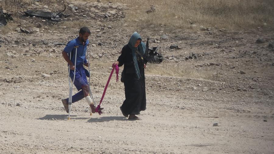 Wife helps her shot husband flee.