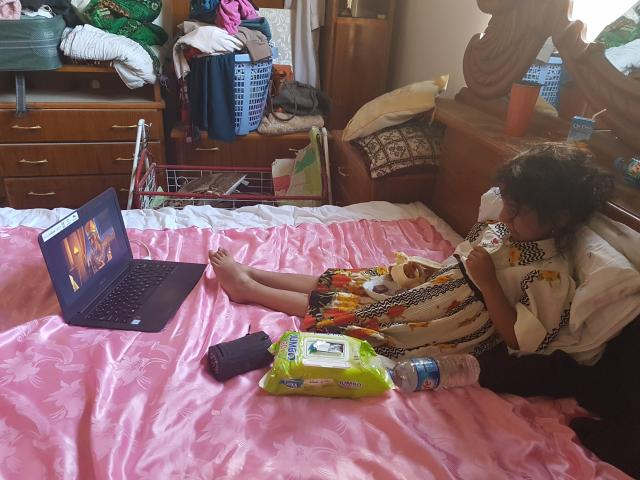 The rescued girl watching CBN's Superbook