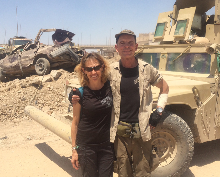 Karen and I and our Humvee the Iraqi Army so graciously let's us use. It has been hit over 20 times and was hit by a mortar after this photo but it keeps moving!