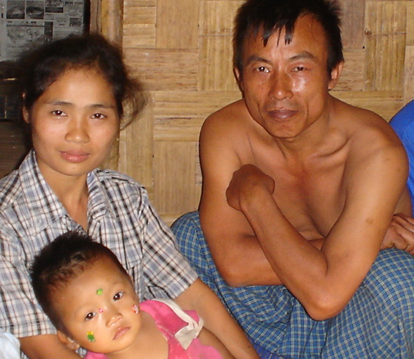 Mucu, his wife, and one of his children in a Karenni refugee camp in Thailand 2000.