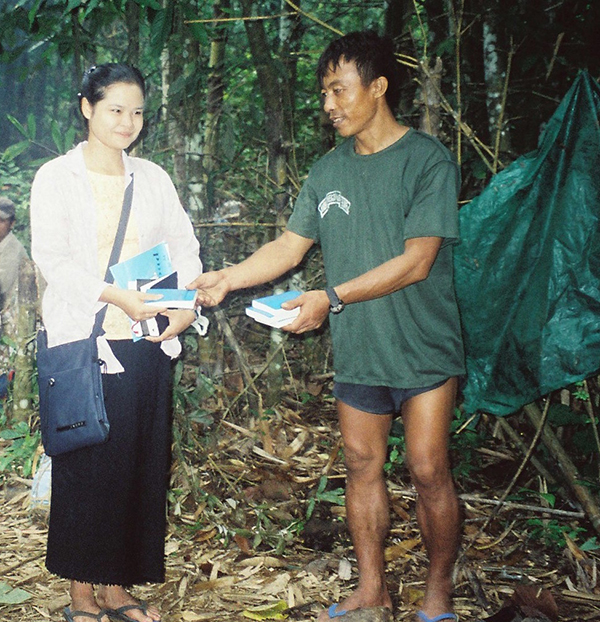 Mucu hands out bibles during a relief mission in Karen State, Burma, 1998.
