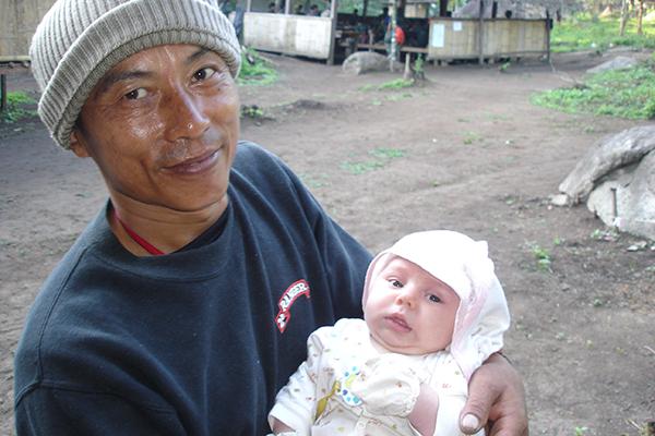 Mucu, uncle to our children, with Peter, three weeks old, in Tha U Wa Camp, Karen State, Burma, 2005.
