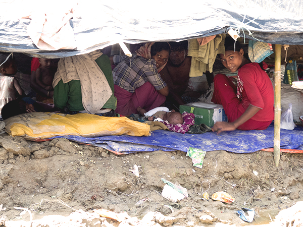 A family peeks out from their tent in one of the refugee camps.
