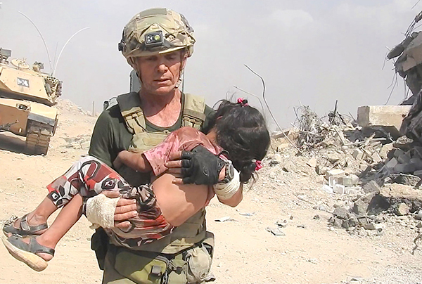 Dave with girl rescued from ISIS kill zone, Mosul, 2 June 2017.