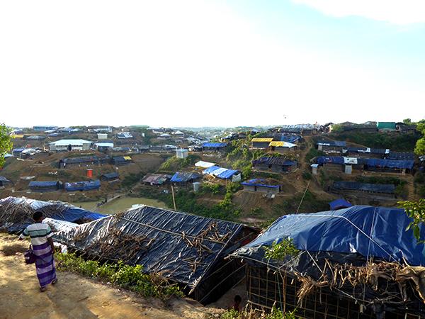 Make-shift homes of bamboo and tarps stretch into the horizon.