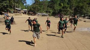 Karen, Shan, Kachin, Kurd/Iraqi, Italian and American rangers race each other in the 100-yard dash of the reunion games.