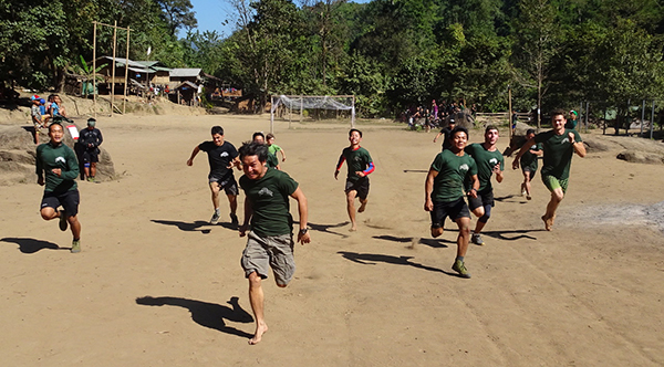 Karen, Shan, Kachin, Kurd/Iraqi, Italian and American rangers race each other in the 100-yard dash of the reunion games.