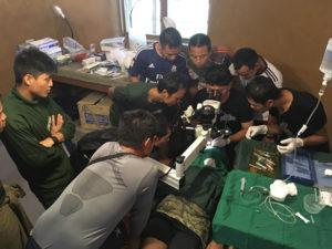 Nay Hser, Dr. Bob, and medics perform a successful cataract surgery.