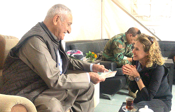 Karen gives gift to Kurdish General Hamid Alfandi.