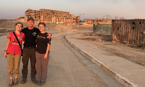 Sahale, myself, and Suu in front on the street where we rescued Demoa with the help of an Iraqi tank and US smoke.