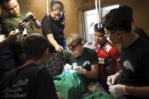 D.r Bob and medics operate.