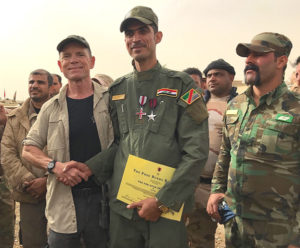 Presenting valor and wounded medals to a Iraqi hero friend.