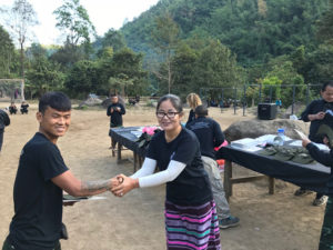 20-year ranger gives award to one of our Shan rangers.