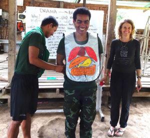 Karen helps teach the GLC anatomy apron to a new Arakan team.