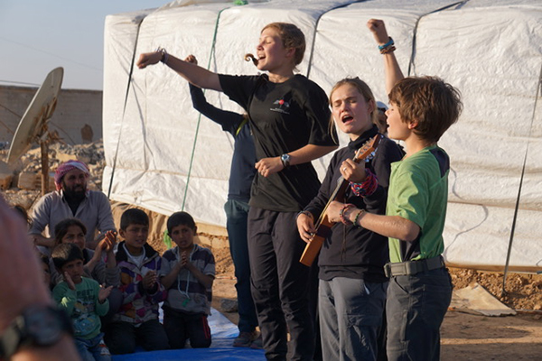 Kids sing at GLC program outside Raqqa.
