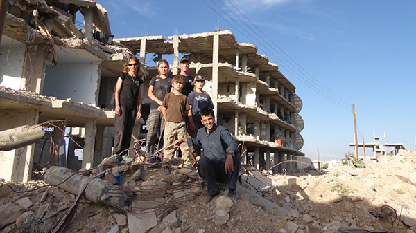 Bashir and some of our team in the ruins of Kobani.