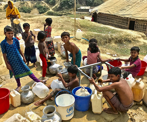 Rohingya refugees getting water from a pump in one of the camps.