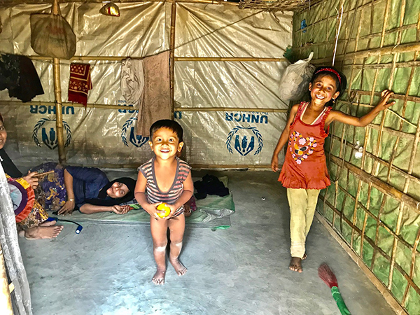 Surprised by smiles in a Rohingya refugee hut.