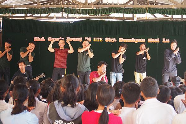 Rangers teaching a song during a GLC program.
