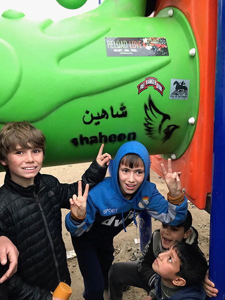Pete and friends at the new playground built in Shaheen's honor in Mosul.