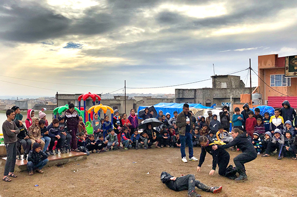 The team performs a Good Samaritan play for families at new play ground in Mosul, February 2018.