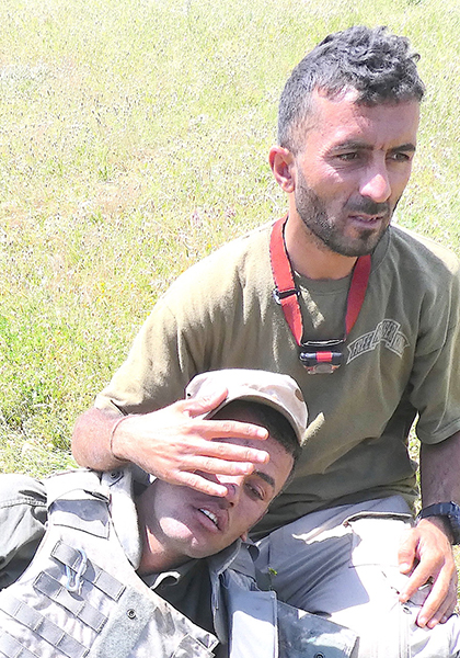 Shaheen taking care of a wounded Iraqi soldier one hour before he was killed saving Aisha and her father on 4 May 2017.