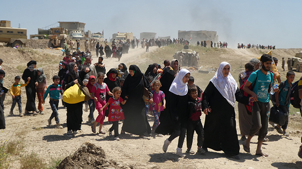 Families flee ISIS in Mosul, May 2017.