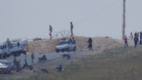 FSA militants on their position north of Menbij.