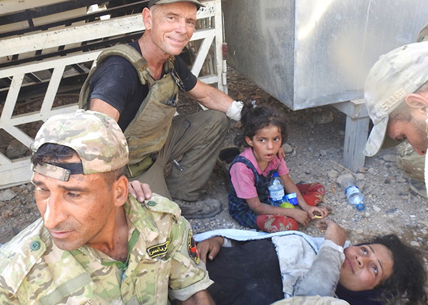 Dave, Zuhair, the little girl and one other woman who was rescued at the same time.