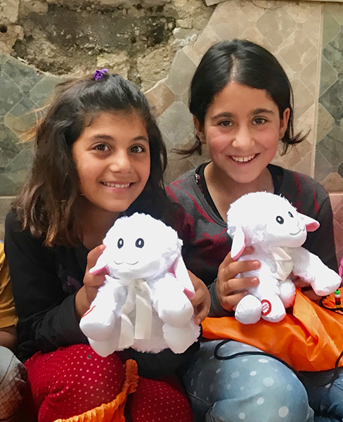 Yezidi girls with lions and lambs provided by Victor Marx from All Things Possible Ministries.