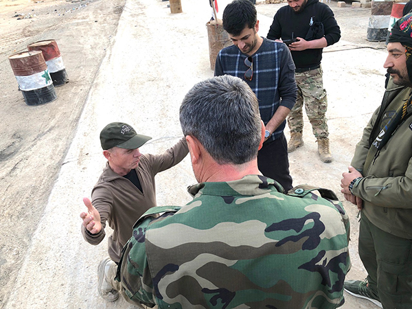 Praying with the Syrian Army as the SDF Kurds look on