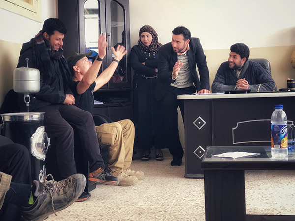 Praying with local school leaders in Tabqa