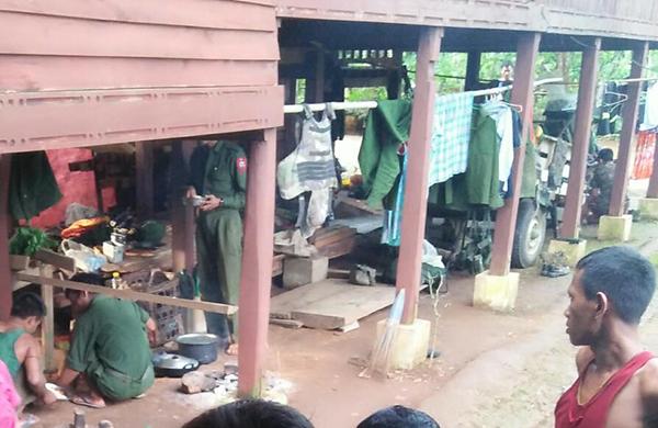 Burma Army soldiers using a civilian home in Ta La All Kho Village.